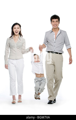 Porträt einer Familie von drei - Stockfoto