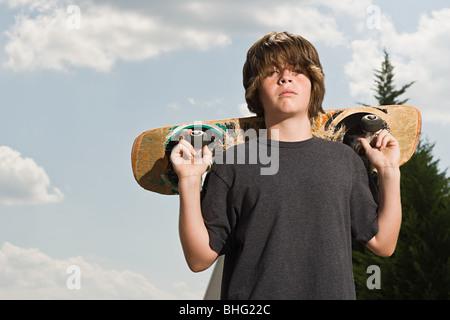Junge mit einem skateboard - Stockfoto