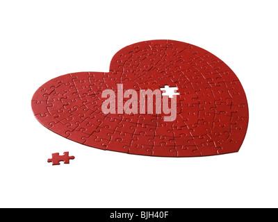 rotes Herz geformt Jigsaw Puzzle auf weißem Hintergrund - Stockfoto