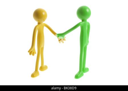 Miniatur-Rubber Figuren schütteln Hände - Stockfoto