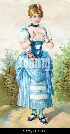 Frau im blauen Kleid mit rosa Rosen - Stockfoto