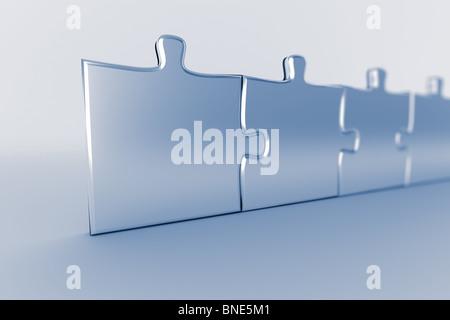 Reihe von angeschlossenen Puzzleteile - Stockfoto