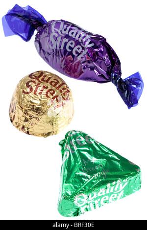 3 Quality Street verpackt Schokolade mein lila mein grünes Dreieck und meine Wirbel-Karamell - Stockfoto