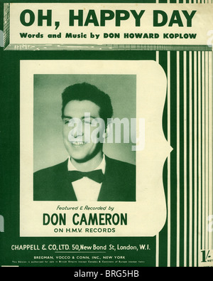 DON CAMERON UK Sänger zu den Noten von den riesigen 1952 traf Oh, Happy Day von US-Songwriter Don Koplow - Stockfoto