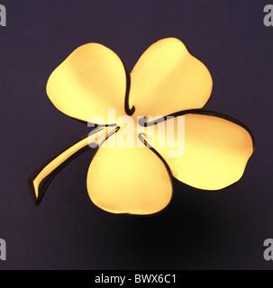 Glück Glück Glück Glücksbringer gold Neujahrs Eves Symbol 4-blättrige Kleeblatt shamrock - Stockfoto