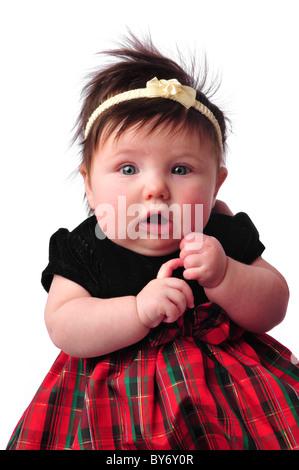 Baby auf weiß kariertes Kleid Finger zählen - Stockfoto
