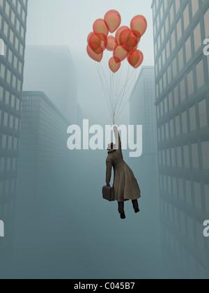 Geschäftsmann, soaring am Ballon in Stadt - Stockfoto