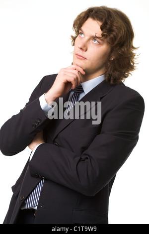 Porträt von nachdenklich Geschäftsmann berühren sein Kinn beim Denken - Stockfoto