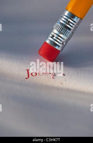 Studioaufnahme des Bleistifts löschen die Wort-Jobs aus Papier - Stockfoto