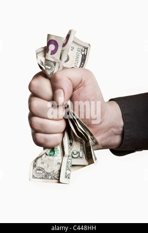 Ein Mann, ein Bündel von uns greifen Geldschein, close-up von hand - Stockfoto