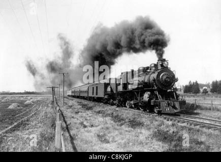 Dampfzug bewegt sich die Bahnen um 1900 - Stockfoto