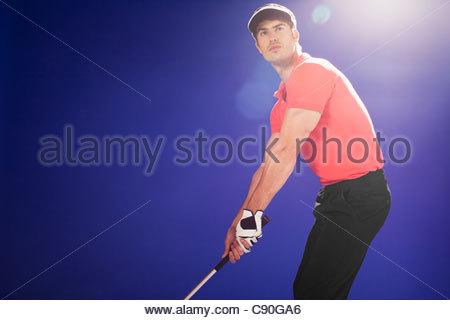 Golfspieler bereit, swing club - Stockfoto
