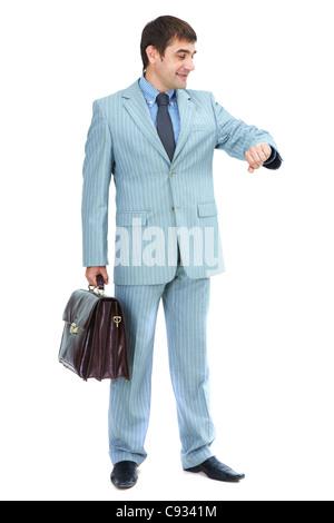 Porträt von eleganten Geschäftsmann im grauen Anzug Blick auf seine Uhr isoliert - Stockfoto