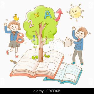 Junge und ein Mädchen in Schuluniform mit einem Buch-Baum - Stockfoto