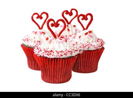 Schokoladentörtchen mit Vanille Zuckerguss zum Valentinstag, Valentinstag. - Stockfoto