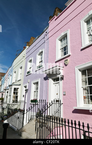 Pastell farbigen Terrassenhäuser in Bywater Street. - Stockfoto