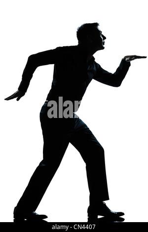 ein kaukasischer Mann lustige ägyptischen Stil zu Fuß in voller Länge Silhouette in weißem Hintergrund Studio isoliert - Stockfoto