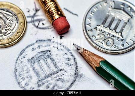 Griechische Drachmen und eine gelöschte Eurozeichen, symbolisches Bild von den möglichen Wegfall des Euro in Griechenland - Stockfoto