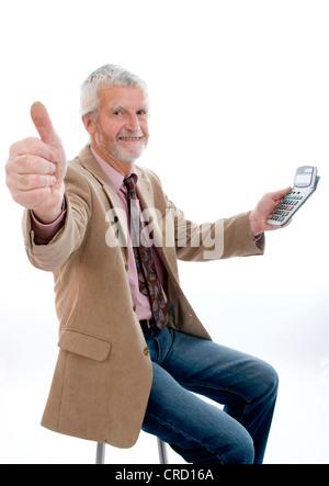 ältere, erfolgreich Businesman mit Taschenrechner - Stockfoto
