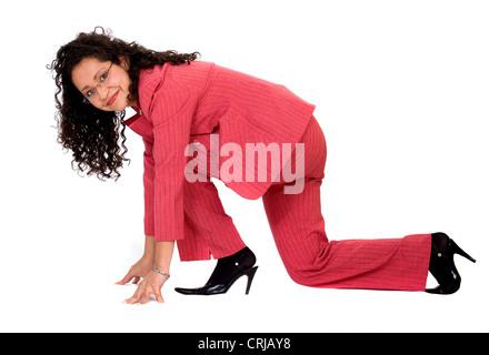 Starten Sie Ihre Karriere - Frau auf dem Boden im racing-position - Stockfoto