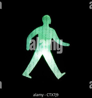 Grüner Mann zu Fuß - Stockfoto