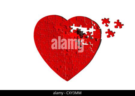 Roten herzförmigen Jigsaw Puzzle, unvollständig - Stockfoto