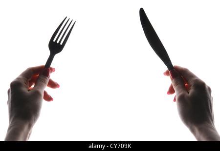 Hände mit Messer und Gabel - Stockfoto