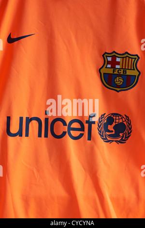 UNICEF-Logo auf den FC Barcelona Fußball orange gefärbt Fußballtrikot - Stockfoto