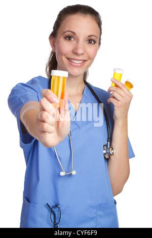 Krankenschwester mit Pillen Flasche - Stockfoto