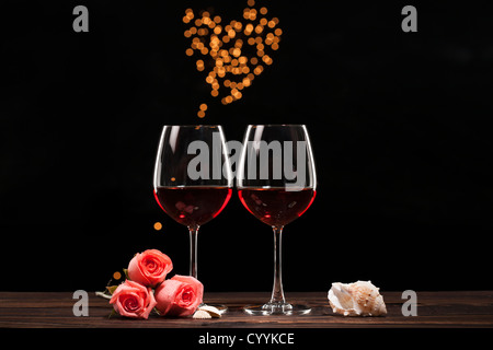 Rotwein und herzförmigen glitzernden Licht - Stockfoto