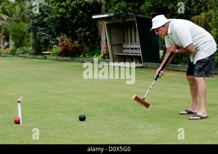 Krocket-Player spielt Krocket in einem Club. - Stockfoto