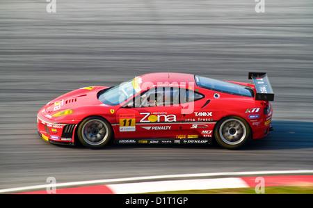 JimGainer Ferrari Auto konkurrieren beim Super GT Race am 20. Juni 2010 in Sepang Circuit, Malaysia. - Stockfoto