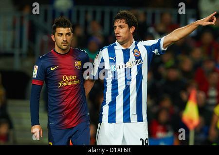 David Villa (FC Barcelona) und Capdevila (RCD Espanyol), während La Liga Fußball match zwischen FC Barcelona und - Stockfoto