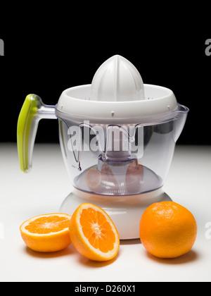 Orangensaft zusammendrückenden Maschine - Stockfoto
