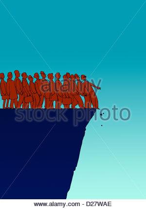 Business-Leute am Rand der Klippe - Stockfoto