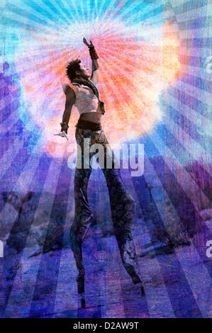 Verkörpern Sie Ihre höchsten selbst. Mann auf Stelzen von Strahlen umgeben. - Stockfoto