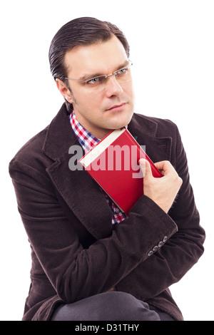 Porträt von ein hübscher junger Mann hält ein Buch auf weiß - Stockfoto