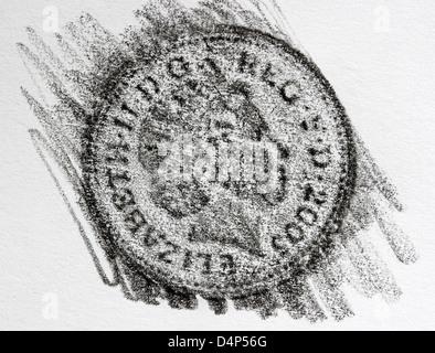 Bleistift Einreiben mit einer £1 Münze - Stockfoto
