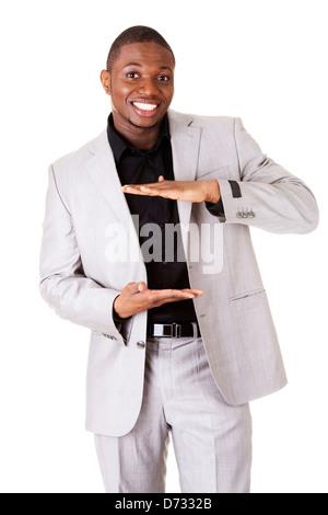 Geschäftsmann präsentiert etwas in seiner Hand, isoliert auf weiss - Stockfoto
