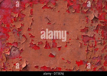 rote Farbe abplatzt oder altes Metall lackiert Textur - Stockfoto