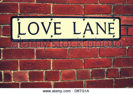Liebe Spur Schild an Wand - Stockfoto