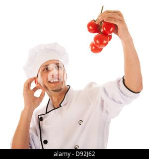 Kochen Sie mit frischen Haufen Tomaten isoliert auf weißem Hintergrund - Stockfoto