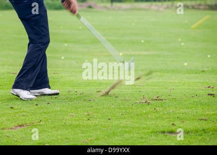 Auswirkungen einer Golf-Aufnahme - Stockfoto
