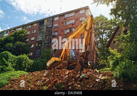 Bagger-Maschine auf der Baustelle während der Erdarbeiten Werke - Stockfoto