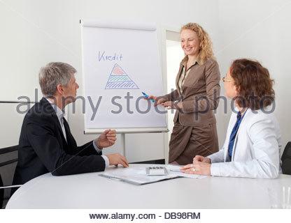 Geschäftsleute in einer Besprechung - Stockfoto