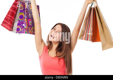 Hübsche Brünette mit Einkaufstüten und schauen sehr glücklich, isoliert auf weiss - Stockfoto