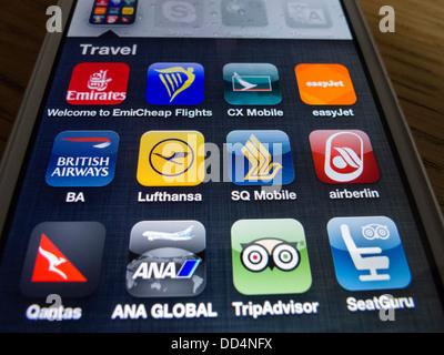 Detail von vielen Reise- und Airline apps auf ein iPhone 5 Smartphone - Stockfoto