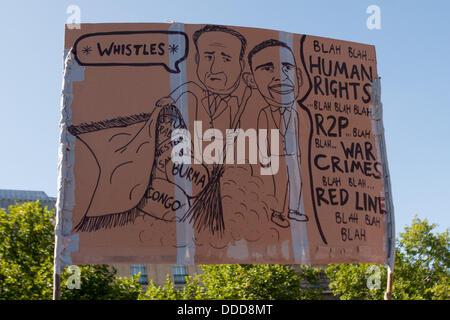 London, UK. 31. Aug, 2013.Placard mit David Cameron und Barak Obama am nationalen Demonstration durch Anschlag gipfelt - Stockfoto