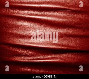 Faltige rot Leder Textur Hintergrund. - Stockfoto