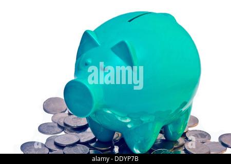 Piggy Bank stehend auf Münzen isoliert auf weiss - Stockfoto